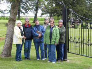 Photo of members of the South West Branch - Manitoba Genealogical Society, during a cemetery transcription visit to the Sparling Cemetery, Manitoba